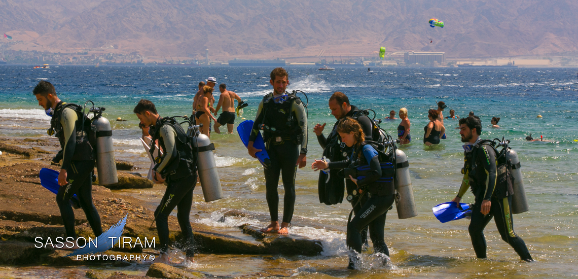 Divers diving school in Eilat with Aqaba background